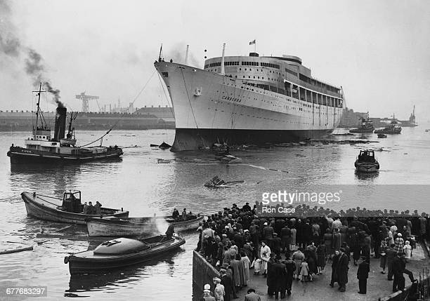 Crowds of people on the quayside look on after the PO Ocean going passenger liner SS Canberra was launched down the slipway by Dame Pattie Menzies...