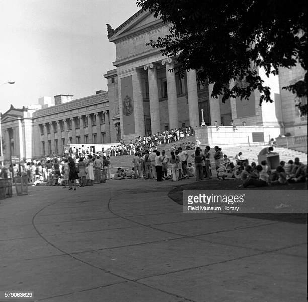 Crowds of people outside Field Museum building at South Entrance waiting to get into King Tut or Treasures of Tutankhamun exhibit Shows Tut banners...
