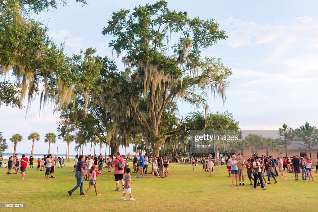 Crowds Of People Play Mobile Pokemon Go Outdoors Florida Stock Photo