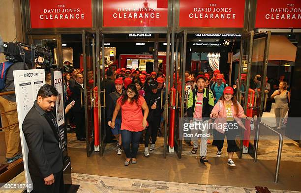 Crowds of people rush inside the David Jones Elizabeth St store during the Boxing Day sales on December 26 2016 in Sydney Australia Boxing Day is one...