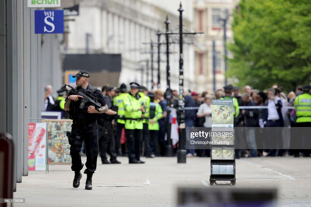 Crowds of people wait outside after police avacuated the Arndale Centre on May 23, 2017 in Manchester, England. An explosion occurred at Manchester Arena as concert goers were leaving the venue after Ariana Grande had performed. Greater Manchester Police are treating the explosion as a terrorist attack and have confirmed 22 fatalities and 59 injured.