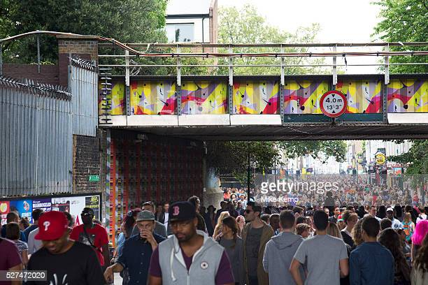 Crowds of people walking down Portobello Road Notting Hill Carnival in West London A celebration of West Indian / Caribbean culture and Europe's...