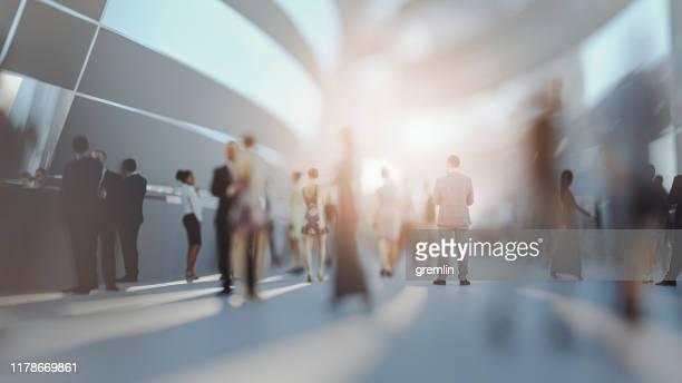crowds of people walking on futuristic street - movimento imagens e fotografias de stock