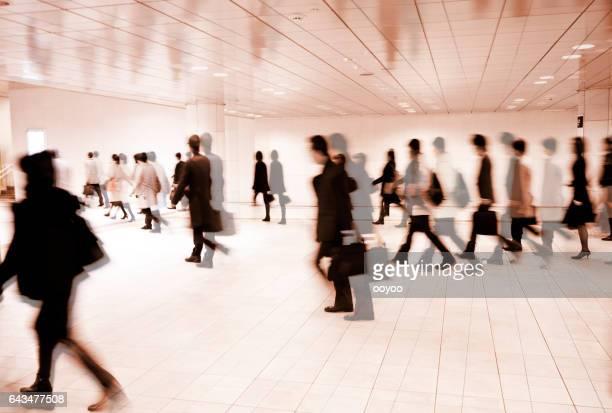 Crowds of People Walking Through Underground Pedestrian Walkway