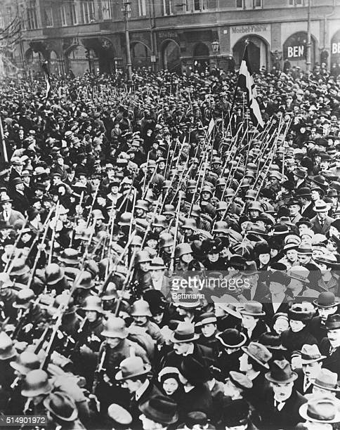 Crowds of people watch the last German troops leaving Danzig which was set to become a 'Free City' surrounded by Poland in 1920