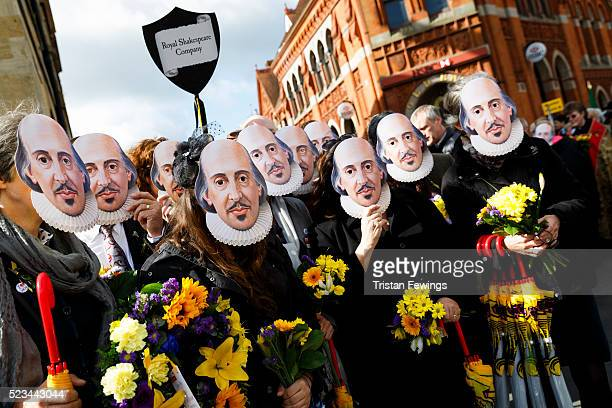 Crowds of people wear William Shakespeare masks during the Shakespeare Birthday Celebration Parade on April 23 2016 in StratforduponAvon England This...