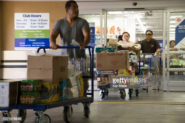 Crowds of people with overweighted shopping carts leave Sam's Club after buying her supplies for Hurricane Lane on Wedesday August 22 2018 in...