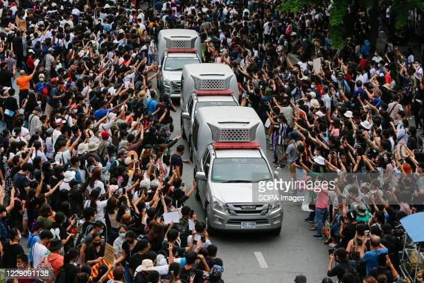 Crowds of protesters raising up their three-finger salute at Ratchaprasong district during the demonstration. Early on under an emergency decree to...