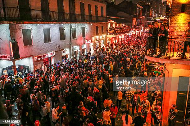 Crowds of revelers and partygoers on Bourbon Street in the historic French Quarter after the Krewe of Bacchus parade during Mardi Gras on February 15...