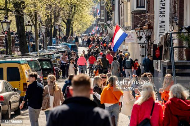 Crowds of revelers are seen during King's Day 2021 on April 27, 2021 in Amsterdam, Netherlands. Due to the coronavirus pandemic, this year's official...