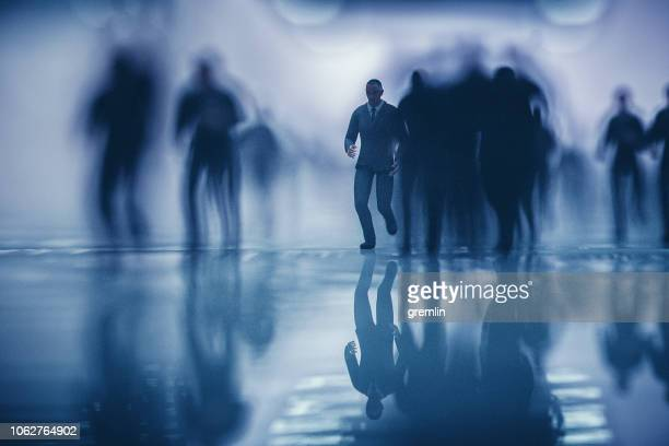 crowds of running business in underground passage - fear stock pictures, royalty-free photos & images