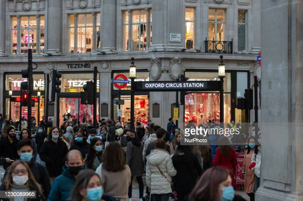 Crowds of shoppers are seen by Oxford Circus underground station, on 12 December, 2020 in London, England. London is at risk of moving into Tier 3...