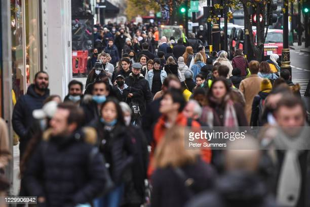 Crowds of shoppers are seen on Oxford Street on December 2, 2020 in London, England. Last night MPs voted in favour of government proposals to enter...