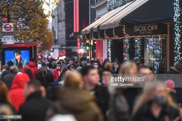 Crowds of shoppers are seen on Oxford street on December 6, 2020 in London, United Kingdom. Earlier this week, England ended a nationwide lockdown...