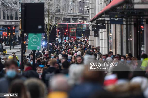 Crowds of shoppers are seen on Regents street on December 6, 2020 in London, United Kingdom. Earlier this week, England ended a nationwide lockdown...