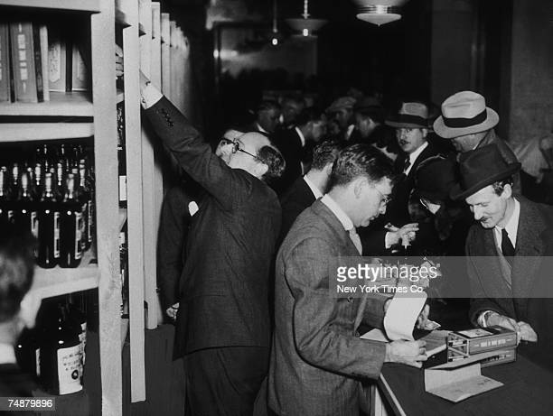 Crowds of shoppers buying liquor legally at Bloomingdale's in New York hours after after the passing of the 21st Amendment to end prohibition 5th...