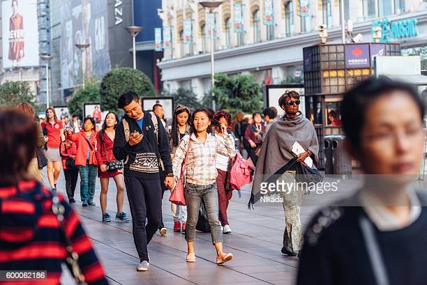 Crowds of shoppers in Shanghai, China