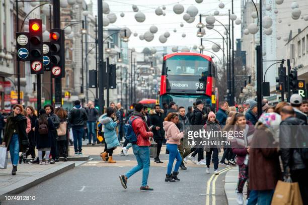 Crowds of shoppers take to Oxford Street in central London on December 26 as Boxing Day sales take place all over the country Troubled UK highstreet...