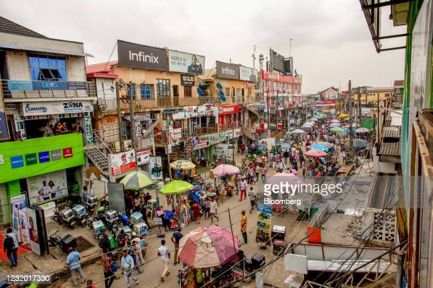 Crowds of shoppers walk through the Ikeja computer village market in Lagos, Nigeria, on Monday, March 29, 2021. Nigerians are having to contend with...