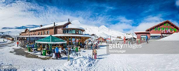 crowds of skiers at kleine scheidegg winter resort alps switzerland - apres ski stock pictures, royalty-free photos & images