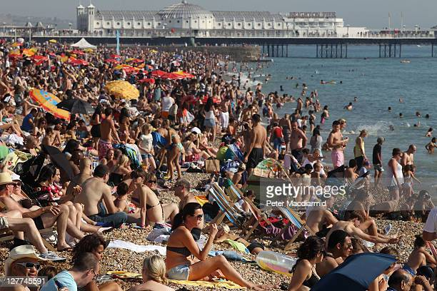 Crowds of sun seekers fill the beach on October 1 2011 in Brighton England Southern parts of the United Kingdom are continuing to enjoy a late season...