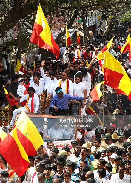 Crowds of supporters accompany Kannada film artists and fraternity members as they take out a rally in protest against the dubbing culture in...