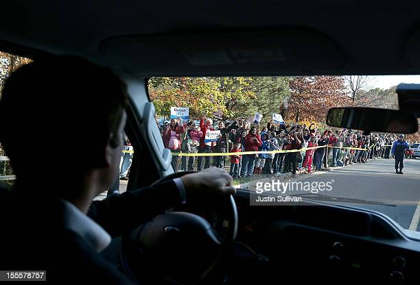 Crowds of supporters are seen from the motorcade of Republican presidential candidate former Massachusetts Gov Mitt Romney before a campaign rally at...