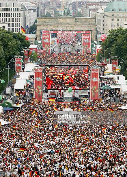 Crowds of supporters of the German and of the Turkish team wave their national flags in the 'Fanmeile' in front of the Brandenburg Gate in Berlin...