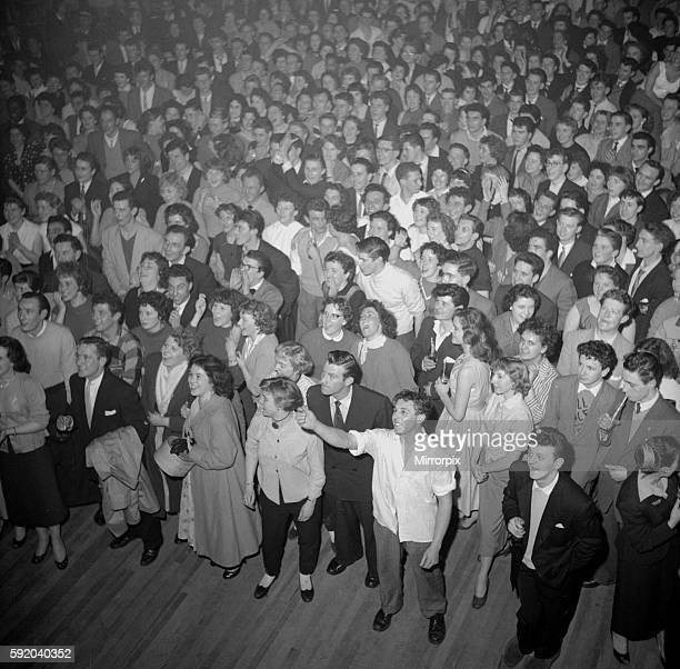 Crowds of teenagers at Hammersmith in London ready to hear rock n roll singer Bill Haley perform with his band the Comets February 1957