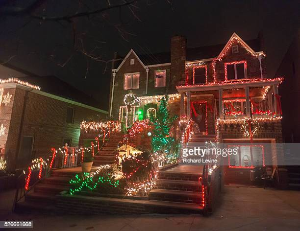 Crowds of tourists and even New Yorkers descend on the Dyker Heights neighborhood of Brooklyn in New York to view the extravagant display of...