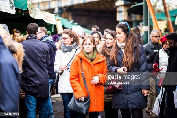 crowds of tourists and people at borough market, london, uk - borough market stock photos and pictures