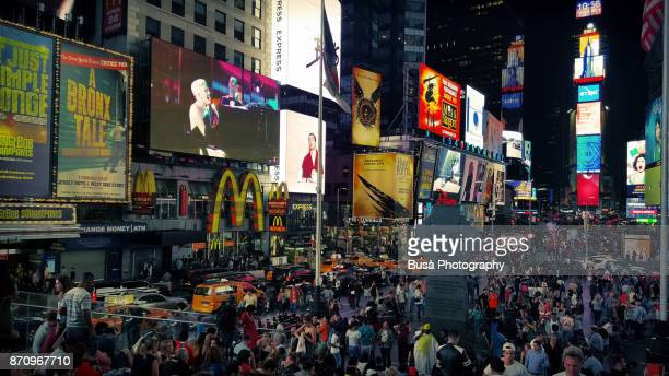 Crowds of tourists and visitors at Duffy Square, in Times Square, Midtown Manhattan, New York City