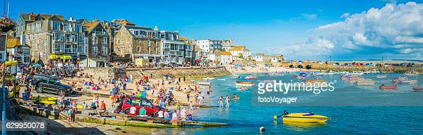 crowds of tourists on harbour beach panorama st ives cornwall - cornwall england stock pictures, royalty-free photos & images