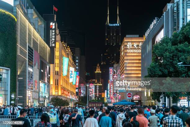 Crowds of tourists walk along Nanjing Road and the Bund on the weekend, In Shanghai, China, Oct 11, 2020.- PHOTOGRAPH BY Costfoto / Barcroft Studios...
