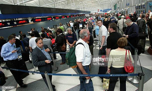 Crowds of travelers are seen in a ticket checkin line in the United Airlines terminal at O'Hare International Airport May 20 2005 in Chicago Illinois...