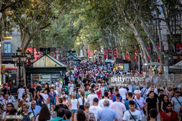 Crowds of visitors make their way down Las Ramblas avenue in Barcelona, Spain, on Wednesday, Sept. 4, 2019. Sterlings decline has made U.K. Travelers...