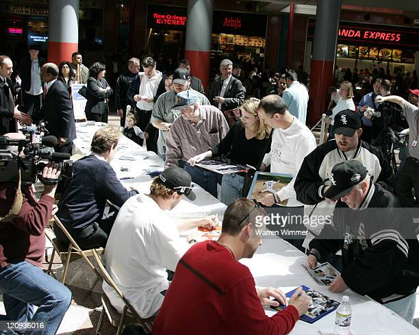 Crowds of White Sox fans turned out today to get autographs of Chicago White Sox Mark Buehrle Chris Widger and announcer Ed Farmer to support Organ...