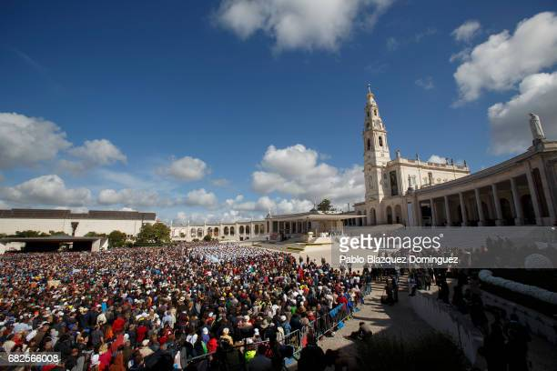 Crowds of worshippers gather during a mass with Pope Francis at the Sanctuary of Fatima on May 13 2017 in Fatima Portugal Pope Francis is attending...