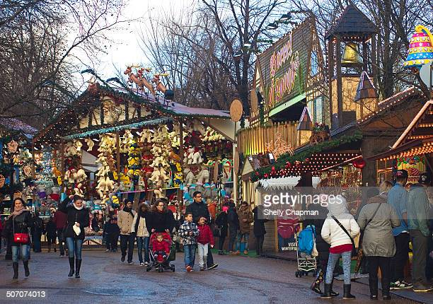 Crowds on a cold wintry day at Winter Wonderland attraction amongst different stalls, Hyde Park, London.