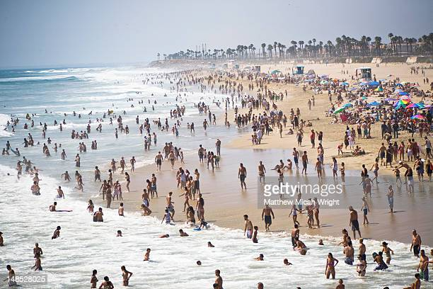 crowds on beach at us open of surfing. - orange county crowded beaches stock pictures, royalty-free photos & images