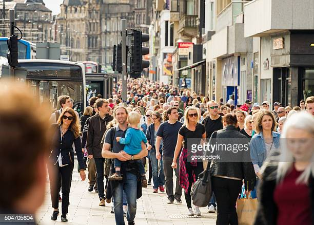 Crowds on busy British shopping street in summer