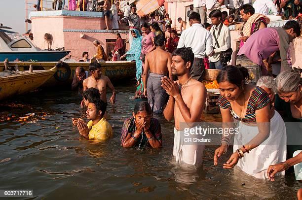 Crowds on Ghat, Banks of Holy river Ganges, Varanasi, India.