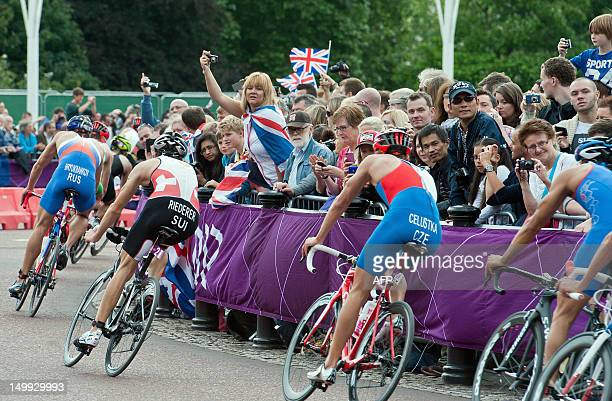 Crowds on Queen Victoria Monument near Buckingham Palace cheer while Russia's Alexander Bryukhankov Switzerland's Sven Riederer and Czech Republic's...