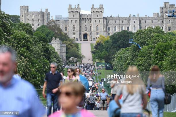 Crowds on the Long Walk beside the castle on May 18, 2018 in Windsor, England. The Berkshire town, west of London will host the wedding of Prince...