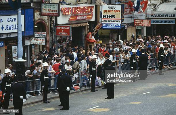 Crowds on The Strand in London to watch the wedding procession of Prince Charles and Lady Diana Spencer London 29th July 1981