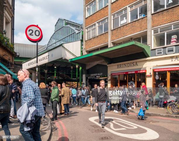 crowds outside borough market in london - borough market stock photos and pictures