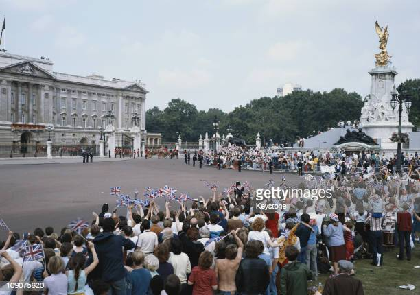 Crowds outside Buckingham Palace in London, during the wedding of Charles, Prince of Wales, and Lady Diana Spencer, 29th July 1981.