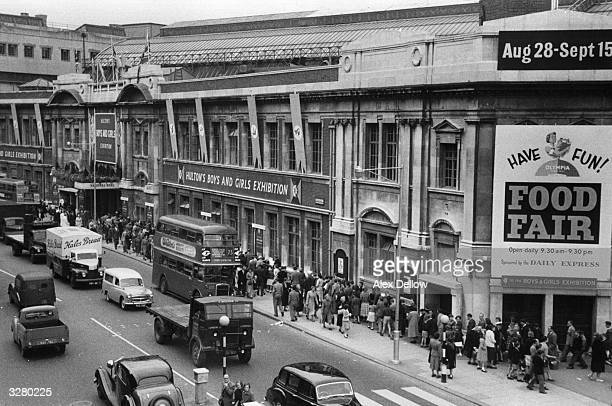 Crowds outside Hulton Photo Library's 'Hulton's Boys and Girls Exhibition' held at Olympia in London