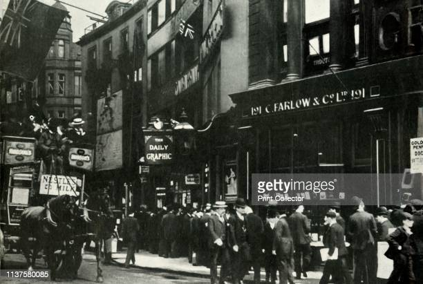 """Crowds outside the Daily Graphic offices in the Strand, waiting to hear about the 'People's Budget' 1909, . People outside the office of the """"Daily..."""