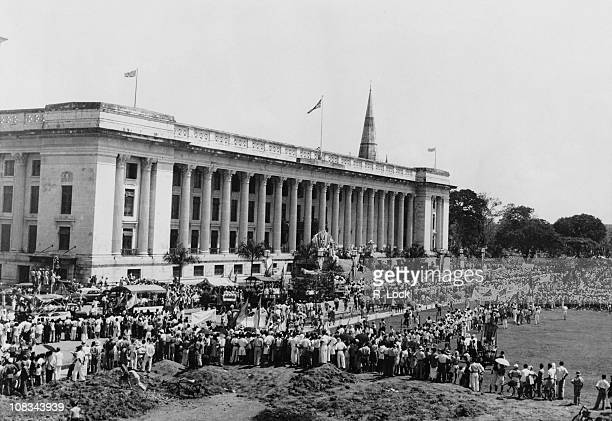 Crowds outside the Municipal Building to watch the first anniversary parade following VJ Day Singapore 25th September 1946